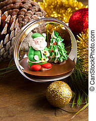 christmas decoration and santa claus chocolate on wooden...