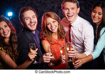 Happy friends - Group of joyful friends toasting with...