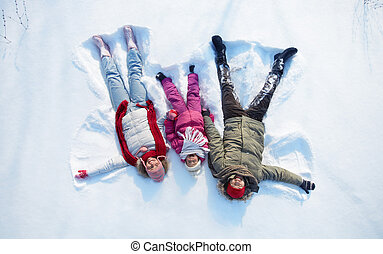 Snow fun - Happy parents and their daughter having fun in...