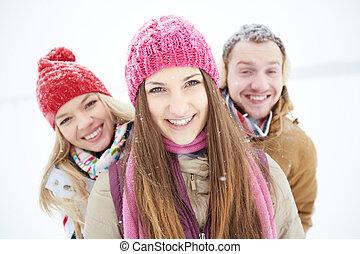 Girl in winterwear - Portrait of happy friends looking at...
