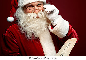 Kind Santa Claus - Portrait of happy Santa Claus holding...