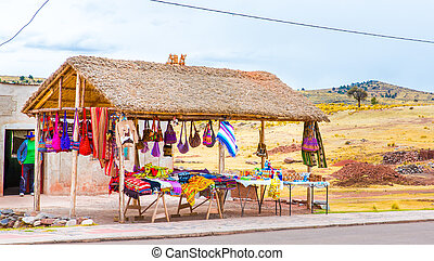 Souvenir market near towers in Sillustani, Peru,South...