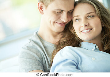 Happiness - Portrait of amorous young couple enjoying rest