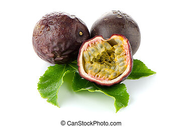 Fresh passion fruit with green leaves isolated on a white...