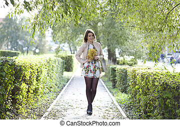 Beautiful woman in the autumn park