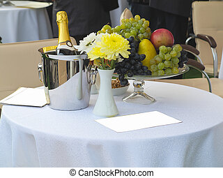 Table set for romantic dinner with champagne flowers and...