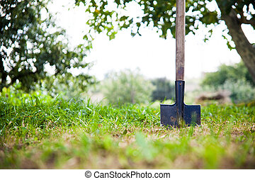 Shovel in the heap of ground - A shovel is stuck in a pile...