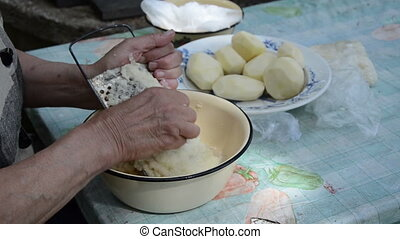 senior hand grater potato