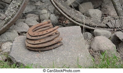 retro horse shoe stone - Stack of retro rusty horse shoes on...