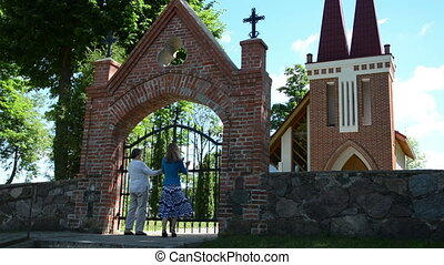 women gates open church - daughter and old mother...