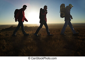 Walking in the sunglow hikers