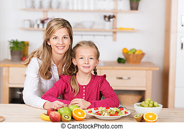 Pretty little girl helping prepare a fruit salad - Beautiful...
