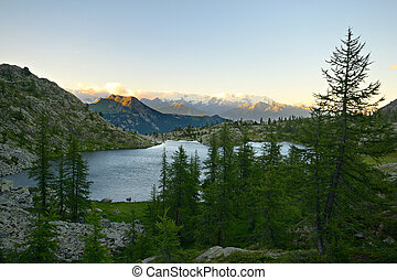 High altitude alpine lake - High altitude mountain lake at...
