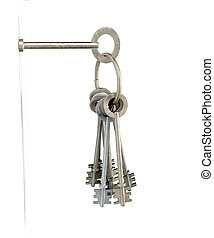 Keys Inserted Into White Wall - A set of old keys on a hoop...