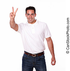 Charismatic male smiling with victory sign