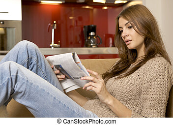 mid adult woman drinking coffee and reading news - mid adult...