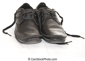 dark leather shoes - a pair of worn dark leather shoes with...