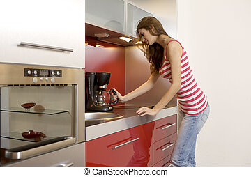 woman standing at the kitchen