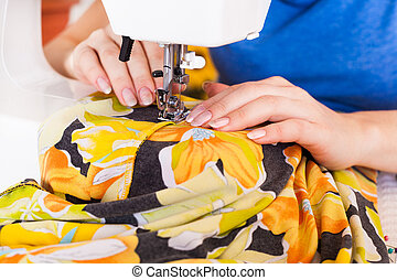 Working from home, a tailor at work. - A tailor working on...