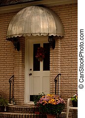 Retro metal door canopy - An umbrella-like dome over front...