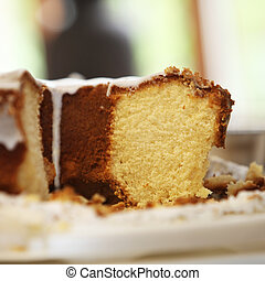 Freshly baked iced cake - Close up view of a portion of...