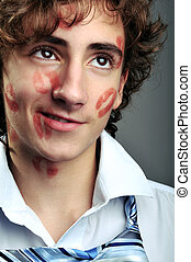 Lipstick kisses - Portrait of young businessman covered in...