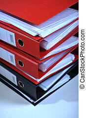 Folders stack - Stack of red folders on desk, deadline...