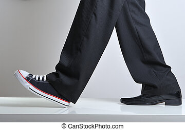 Sport and business - Walking legs with business shoe in a...