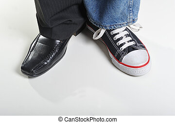 Sport and business - Mans legs wearing jeans and sneakeron...