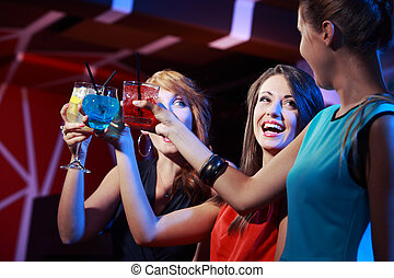 Cocktail party - Portrait of joyful friends toasting at...