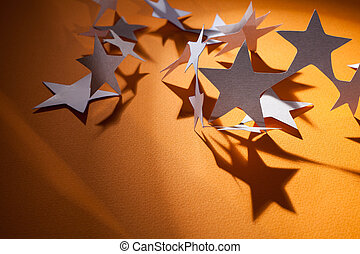 Paper stars group on a colour background - White paper stars...