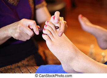reflexology foot massage, spa foot treatment by wood...