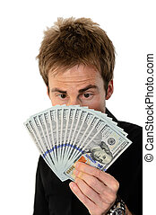 Young man holding hundred dollar bills - A young handsome...