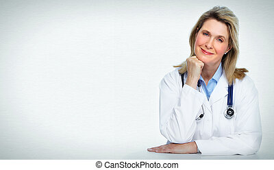 Smiling mature doctor woman Over gray background