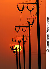 Power energy lines with sun in background