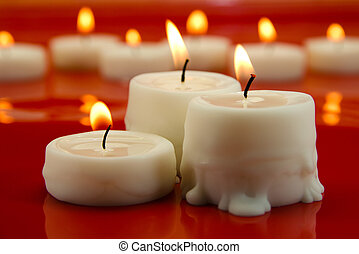 candles - picture of burning candles on red background