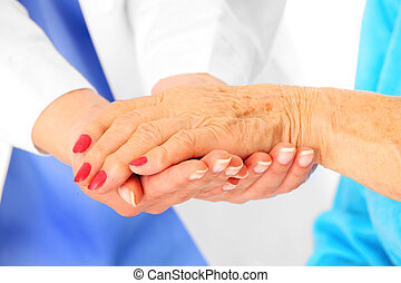 Senior hands - A portrait of senior hands being held by the...