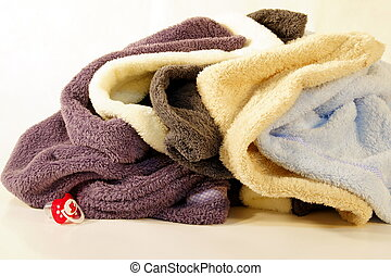 towels rolled up into a ball - clean towels waiting to be...