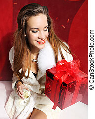 Lady with red gift and champagne