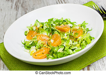 Shredded Brussels Sprout and Tangerine Salad., close up....
