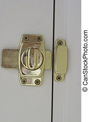 brass door lock the type used on a bathroom