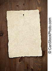 Blank parchment paper on old door. - Blank parchment paper...