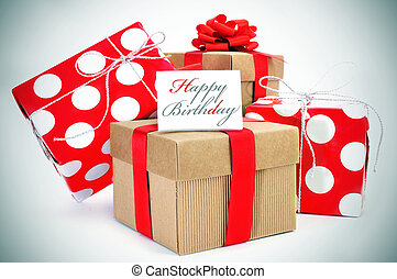happy birthday - a pile of gifts and the sentence happy...