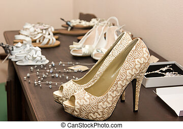 bridal shoes - closeup of bridal shoes on a table
