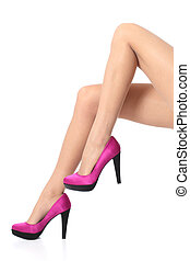 Beautiful woman legs wearing a high stiletto heels isolated...