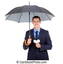 news journalist holding an umbrella - handsome news...