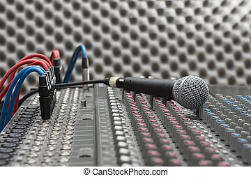 Microphone close-up on the studio mixer