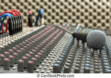 Studio Mixer and Microphone - Microphone on the studio mixer