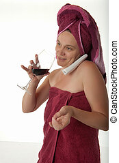 Woman Wrapped in Towels With Phone And Glass Of Wine - A...