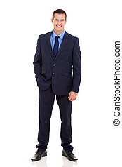 businessman standing with hand in pocket - portrait of...